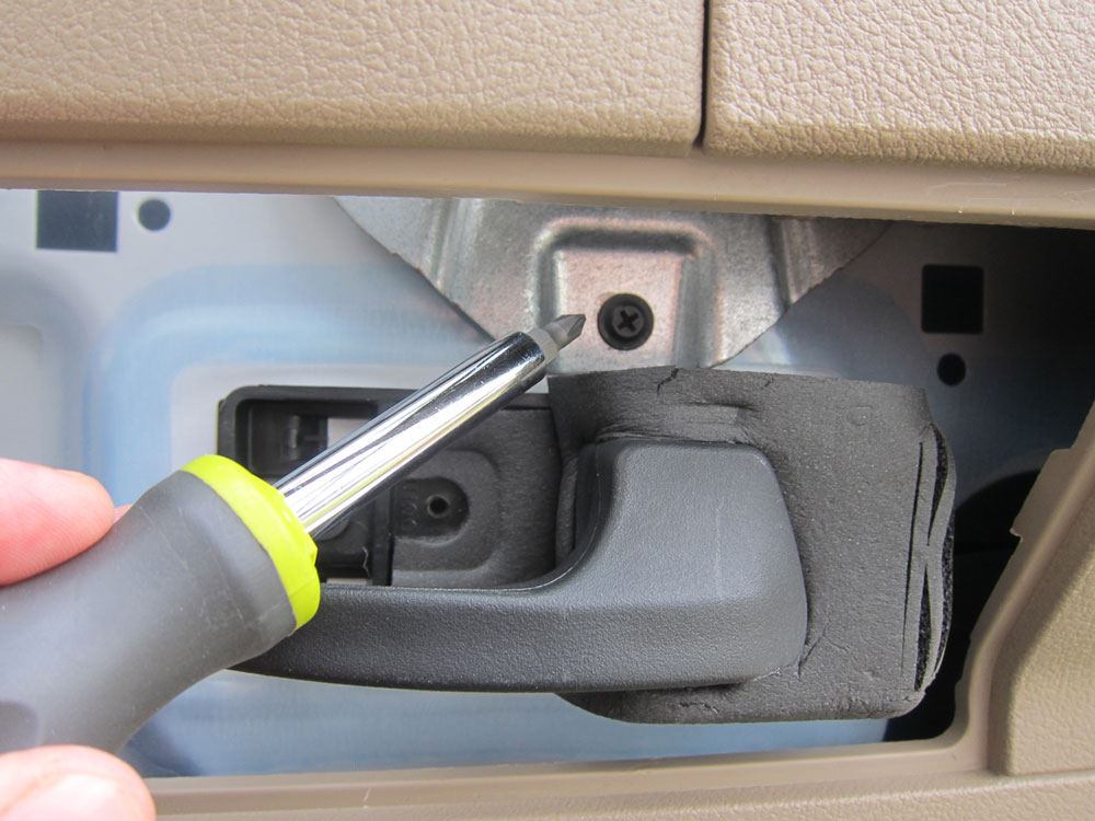 Remove the 4th and final screw that holds the door panel on.
