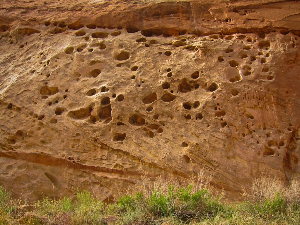 Wind-carved holes in the wall